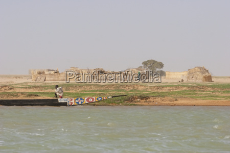 boy standing in boat along the