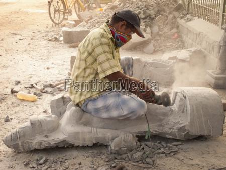 a man carves a statue out