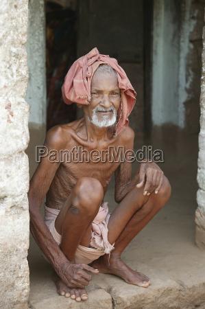portrait of a senior homeless man