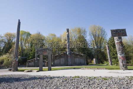totem poles and haida houses on
