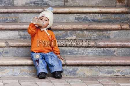 boy sitting on the steps of