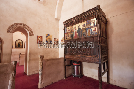 wooden pulpit with icons in the