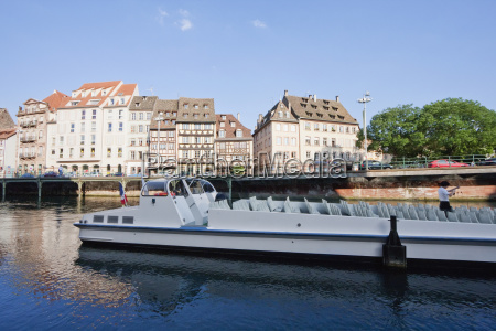tour boat by alsatian houses on