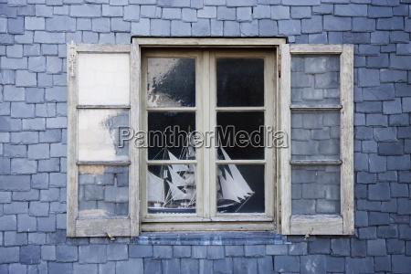 sailing ship model in a window