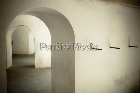 archways inside a building with white