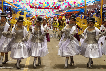 morenada dancers in the procession of