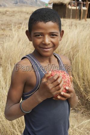 boy with homemade football anja fianarantsoa