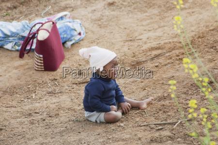 boy in a field along the