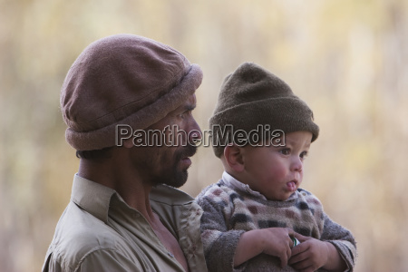 man holding a small boy shigar