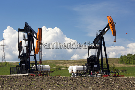 pumpjacks with thunderstorm clouds and blue