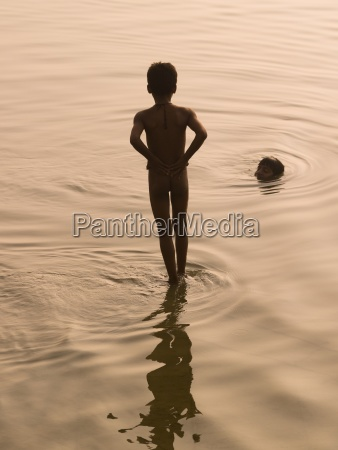 the ganges varanasi indiaboys bathing in