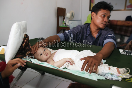 a small child with her father