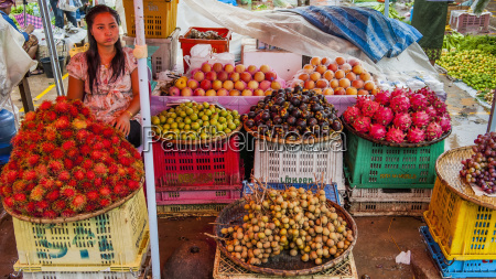 a vendor selling fresh fruit luang