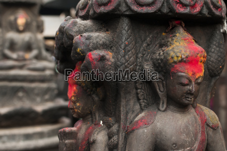 buddhas statues in a small temple
