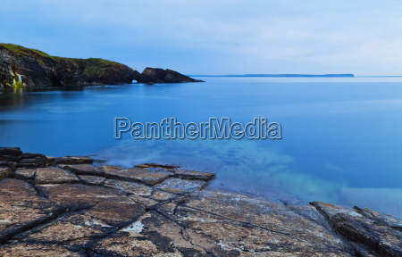 tranquil water along the coastline of