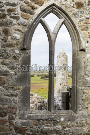 stone church wall with arched window