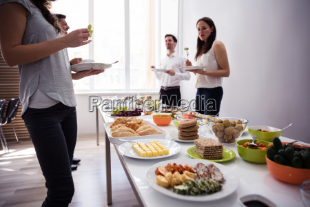 young people eating food at party