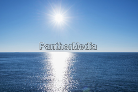 tranquil ocean water reflecting sunlight with