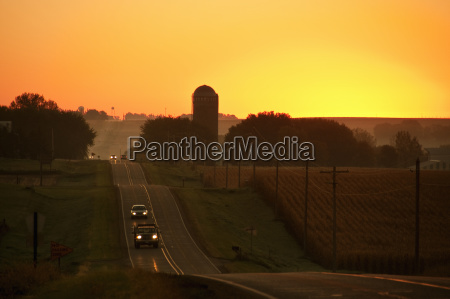a, rolling, country, road, at, sunrise - 25512754