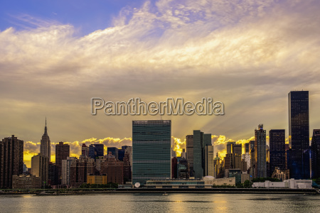 sun setting behind united nations new