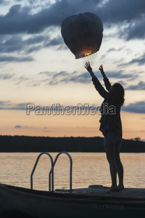 silhouette of a girl releasing a