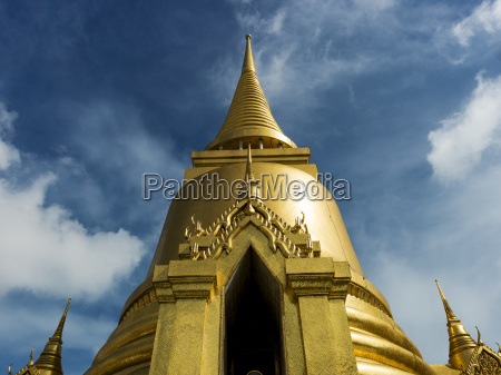 gold structure with spire against a