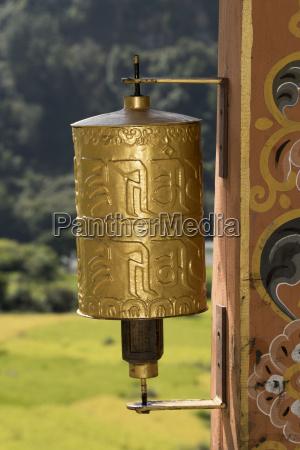 gold prayer wheel bhutan