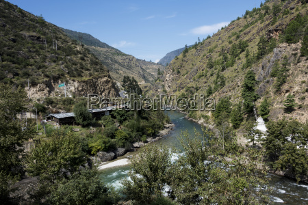 river flowing through a valley bhutan