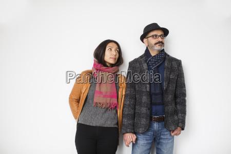 persian man and tibetan woman holding