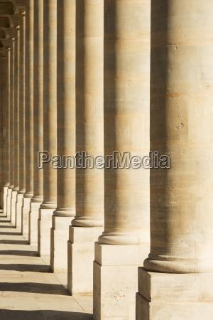 a row of pillars at palais