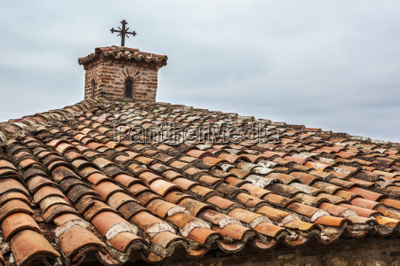 tiles and cross on roof of