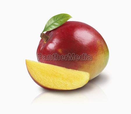a mango with a leaf and