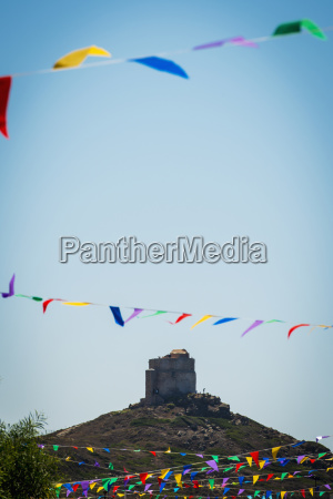 colourful bunting and san giovanni tower