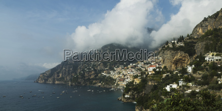 cliffs boats and houses along the