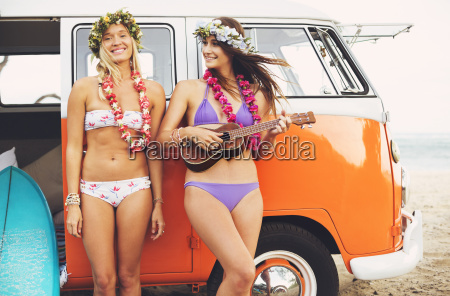beautiful surfer girls with ukulele and