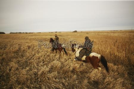 varmint hunter hunting on horseback