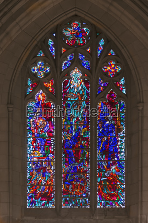 stained glass window in nave of