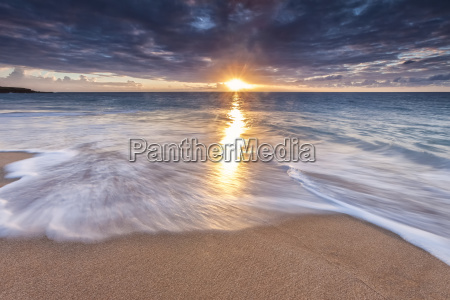 sunlight reflected on the ocean to