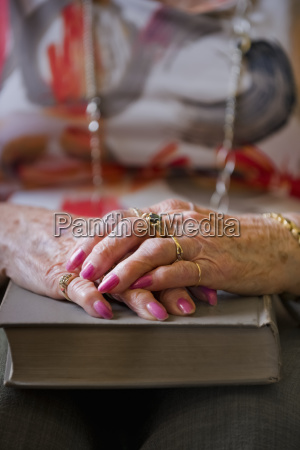 a senior womans hands folded on