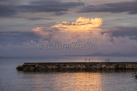 a stone pier out in the