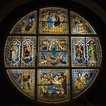 colourful and ornate circular stained glass