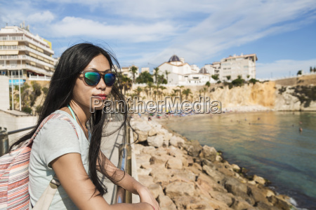 a chinese young woman in sunglasses