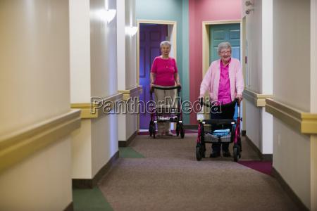senior citizens walking down shared residence