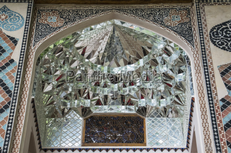 mirrored murqanas in the facade of