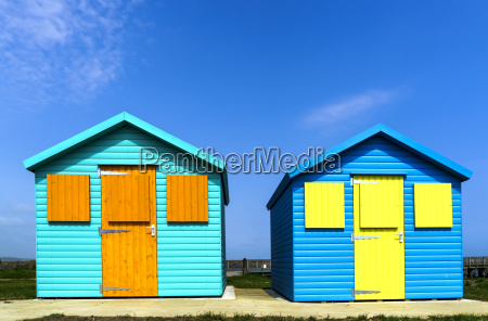 two colourful buildings side by side