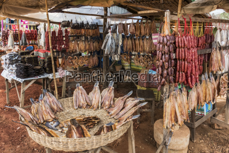 meat hanging on display for retail