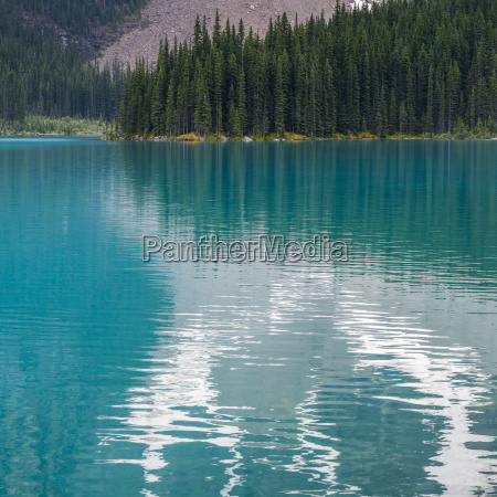 the stunning blue water of moraine