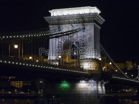 szechenyi chain bridge illuminated at nighttime