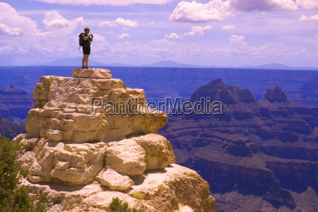 man on top of rock formation