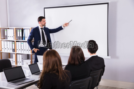 businessman giving presentation to his colleague